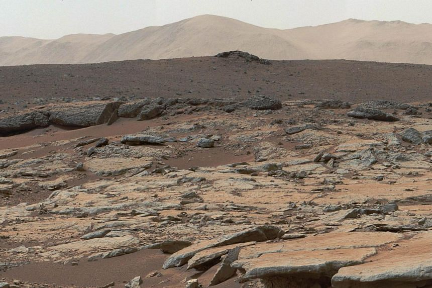 A mosaic of images from the Mast Camera (Mastcam) instrument on NASA's Curiosity Mars rover released on December 9, 2013 shows a series of sedimentary deposits in the Glenelg area of Gale Crater. Mar's surface was found to have remnants of an a
