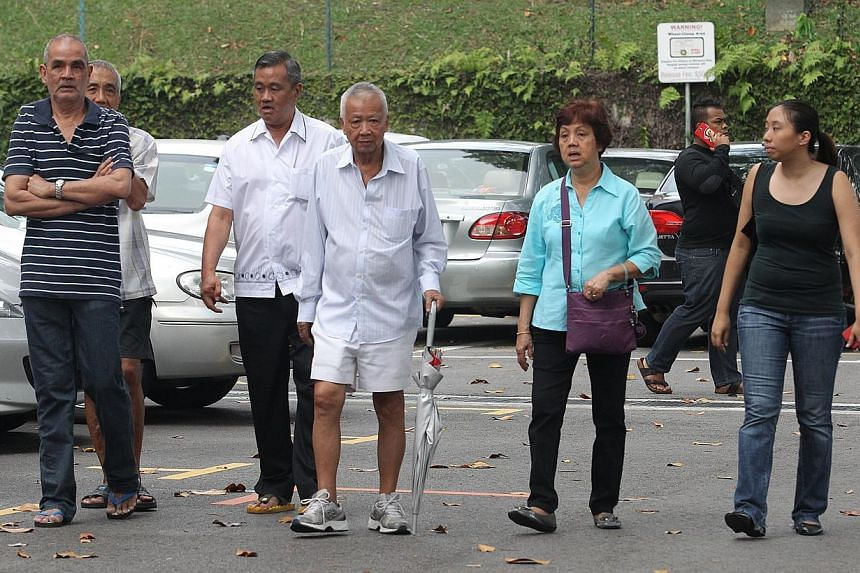 Family of 59-year-old Lee Eng Hock, who was found in the Singapore River on Thursday, Jan 2, 2014, identifies his body at the mortuary on Friday morning. -- ST PHOTO: ONG WEE JIN