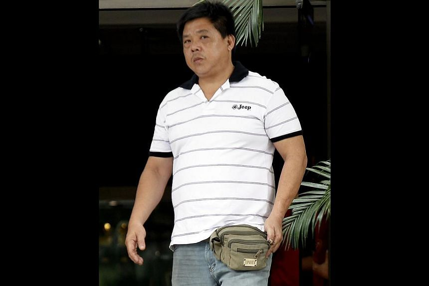 Tan Suan Lee, 44, accused for without a license sell liquors at the Prata City located at 145 Jalan Besar. (Sentencing on Jan 8, 2014). -- ST PHOTO:WONG KWAI CHOW