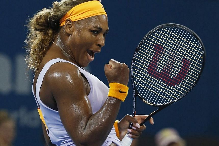 Serena Williams of the US reacts, as she defeats Maria Sharapova of Russia during their women's singles semi-finals match at the Brisbane International tennis tournament in Brisbane, on Jan 3, 2014. -- PHOTO: REUTERS