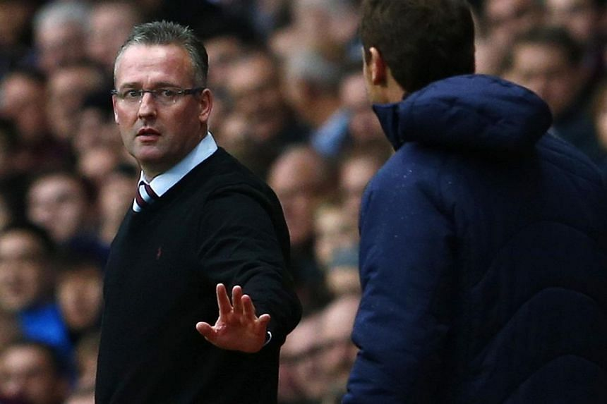 Aston Villa's manager Paul Lambert (left), apologizes to Tottenham Hotspur's manager Andre Villas Boas during their English Premier League soccer match at Villa Park in Birmingham, Northern England, on Oct 20, 2013.The majority of English Premi