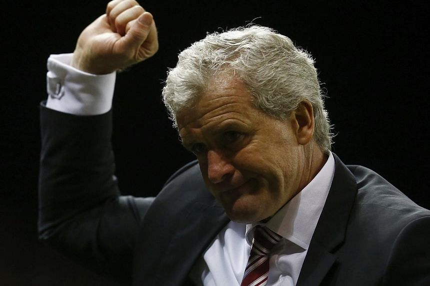 Stoke City manager Mark Hughes celebrates after his side beat Chelsea in their English Premier League soccer match, at the Britannia Stadium in Stoke-on-Trent, central England, on Dec 7, 2013.Hughes has been fined 8,000 pounds (S$16,700) by the