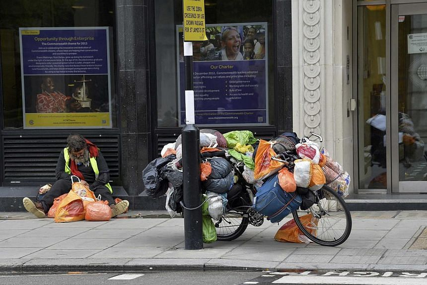 A homeless man with his possessions loaded on a bicycle in London. Societies tend to presume that poor people are unable to handle money. But an innovative programme where 13 homeless men were given a sum of money - no strings attached - has had posi