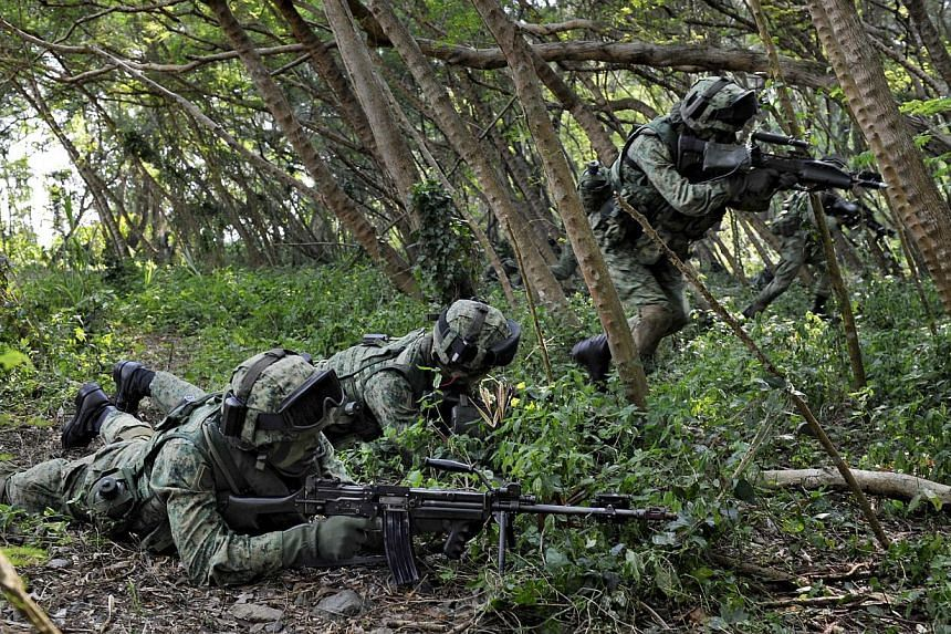 Servicemen from the Singapore Armed Forces (SAF) participate in a military exercise on Pulau Sudong on Aug 2, 2011. The SAF will be conducting military exercises at Seletar, Marsiling, Jalan Bahar, Neo Tiew, Lim Chu Kang, Jalan Kwok Min, Tuas, Upper