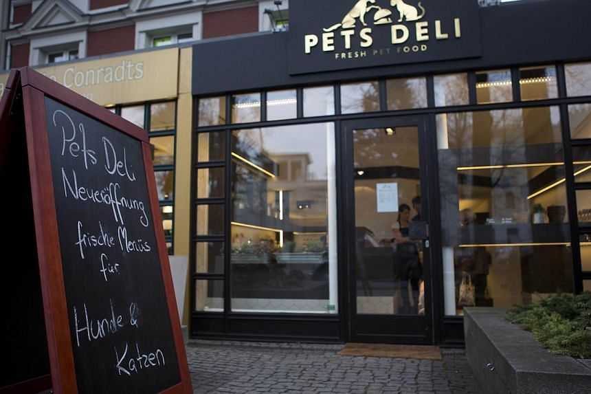 The Pets Deli food shop for dogs and cats is pictured in Berlin's Gruenewald district on Jan 2, 2014. The shop mixes fresh meats, vegetables and other ingredients to prepare meals for the animals which can be eaten on site or taken away. -- PHOTO: AF