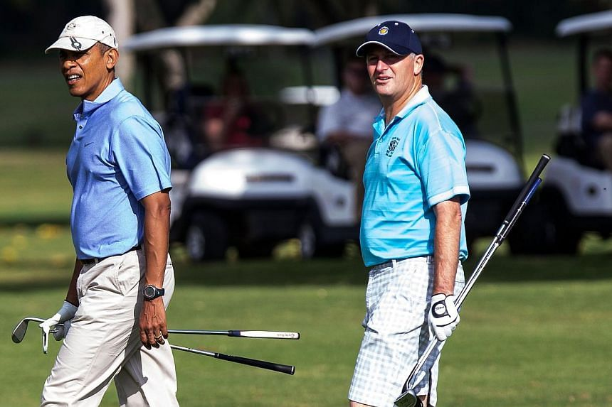 United States (US) President Barack Obama and New Zealand Prime Minister John Key walk from their golf carts to the second hole green at the Kaneohe Klipper Golf Course at Marine Corps Base Hawaii on Jan 2, 2014. The US First Family is in Hawaii for