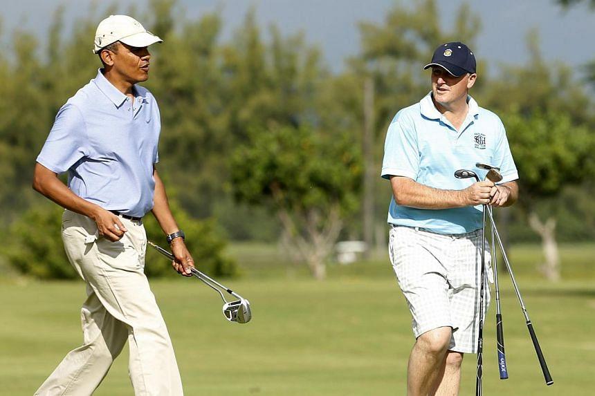 United States President Barack Obama plays golf with New Zealand Prime Minister John Key at Marine Corps Base Hawaii in Kaneohe on Jan 2, 2014. -- PHOTO: REUTERS