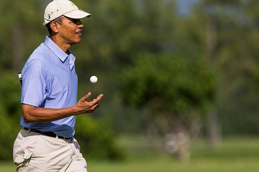 United States (US) President Barack Obama walks on the second hole green at the Kaneohe Klipper Golf Course at Marine Corps Base Hawaii on Jan 2, 2014. The US President was joined by New Zealand Prime Minister John Key, his son Marvin Key and White H