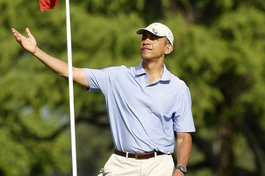 United States President Barack Obama gestures on the second green as he plays golf at Marine Corps Base Hawaii in Kaneohe on Jan 2, 2014. -- PHOTO: REUTERS