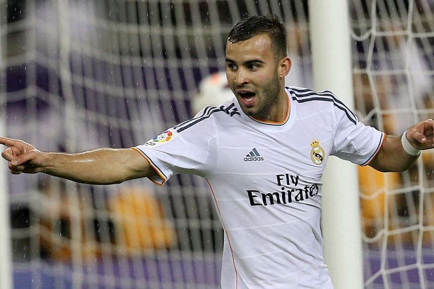Real Madrid's Spanish striker Jese celebrates after scoring his teams' only goal during their friendly football match against Paris Saint-Germain(PSG) at the Aspire Academy of Sports Excellence in the Qatari capital Doha on Jan 2, 2014.Ma