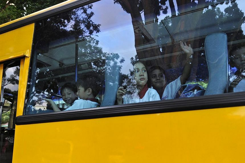 Cash-strappedbus operators have raised school bus fares by between $5 and $20 a month for the new school year as they look to survive amid rising costs. -- ST FILE PHOTO: CAROLINE CHIA