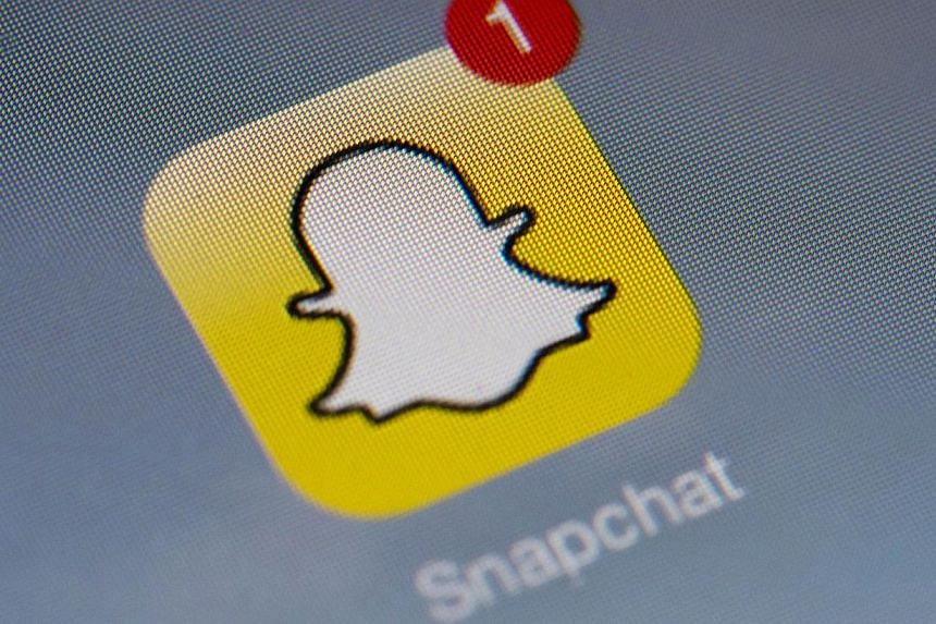 The logo of mobile app Snapchat is displayed on a tablet in Paris on Jan 2, 2014. Snapchat, a private messaging service, said it knew for months about a security loophole that allowed hackers this week to harvest millions of phone numbers and announc