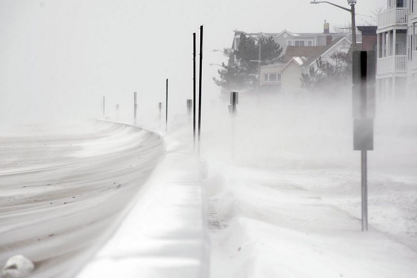 Snow begins to accumlutate along Otis Street in Winthrop, Massachusetts, on Jan 2, 2014. Snowfall in the north-eastern United States caused flight cancellations and airport delays while federal government offices and schools closed due to the foul we