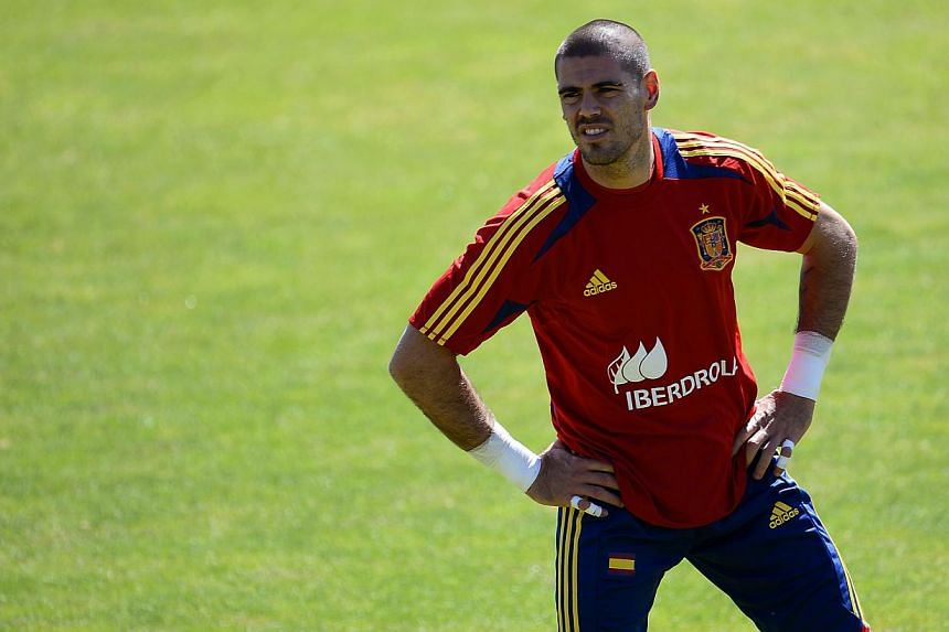 Barcelona goalkeeper Victor Valdes looks on during a training session in Las Rozas on Jun 4, 2013.Doctors have declared Valdes fit and ready to play after 44 days on the sidelines with a right calf strain, the Spanish club said on Thursday. --