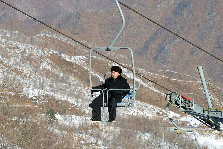 North Korean leader Kim Jong Un sits on a ski lift during a visit to a newly built ski resort in the Masik Pass region, in this undated picture published in North Korean newspaper Rodong Sinmun. -- PHOTO: REUTERS