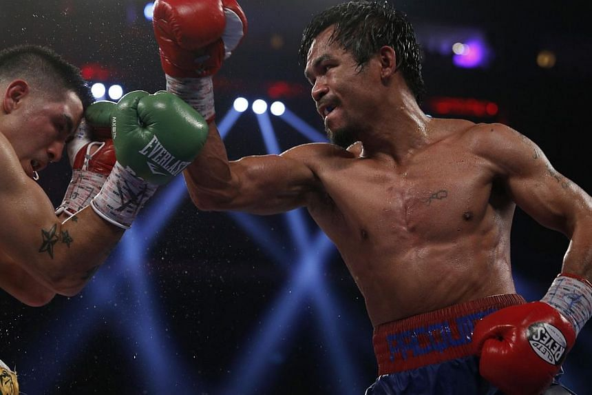 Manny Pacquiao (right) of the Philippines, fights Brandon Rios (left) of the US during their World Boxing Organisation (WBO) International 12-round welterweight boxing title fight at the Venetian Macao hotel in Macau on Nov 24, 2013.Pacquiao ha