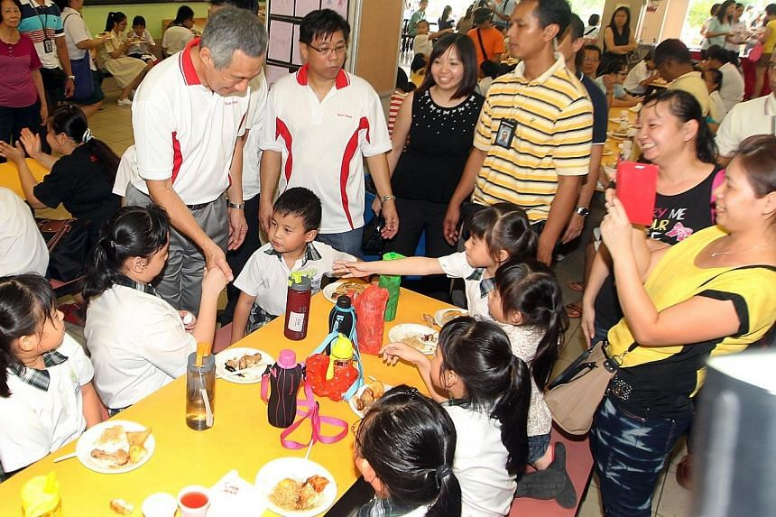 Prime Minister Lee Hsien Loong at a bursary award ceremony in his Teck Ghee ward in Ang Mo Kio GRC. A new centre to help small and medium enterprises (SME) upgrade and do better amid challenging economic conditions will be set up in Ang Mo Kio Commun