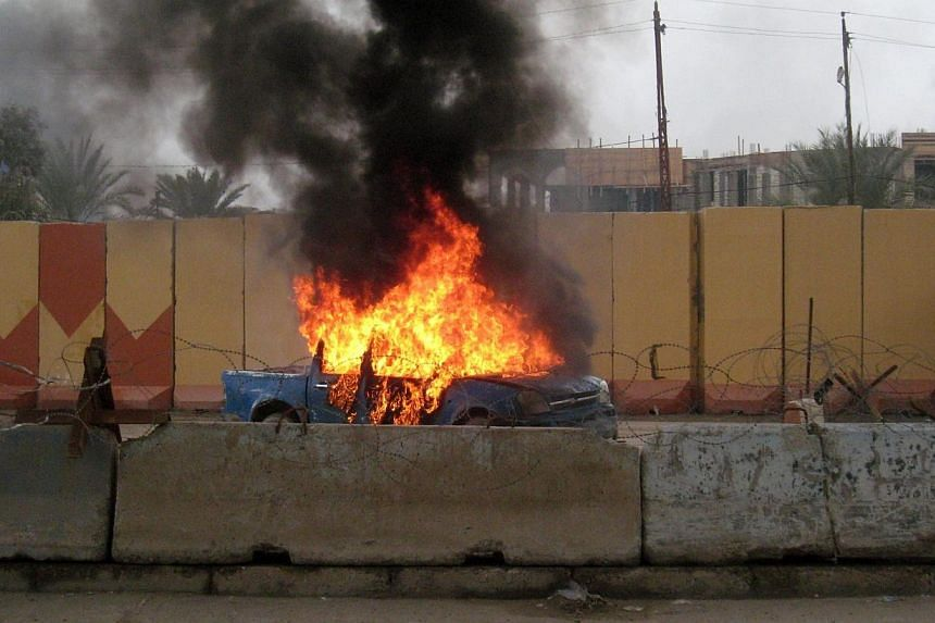 Smoke billows from a police car following clashes between Jihadists and Iraqi forces backed by tribesmen in the Iraqi city of Fallujah, West of Baghdad, on Jan 1, 2014. -- FILE PHOTO: AFP