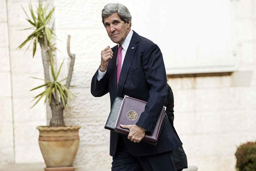 US Secretary of State John Kerry arrives for a meeting at the presidential compound in the West Bank city of Ramallah, on Jan 4, 2014. Kerry held fresh talks on Saturday with Palestinian leader Mahmud Abbas seeking to brush aside bitter Israeli-