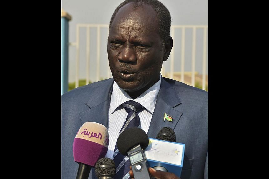 South Sudan's Minister of Information and official government spokesperson Michael Makuei Lueth speaks to the press before leaving Juba International Airport on Jan 2, 2014, headed for Addis Ababa. Face-to-face talks between warring parties in S