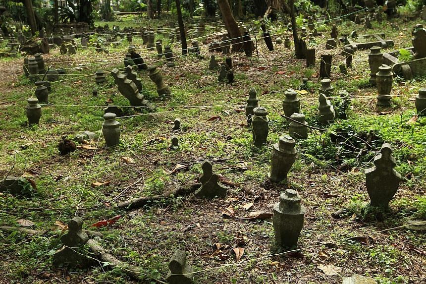 Tags and strings on the graves indicate that surveying works have taken place. It is slated to make way for residential development. -- ST PHOTO: SEAH KWANG PENG