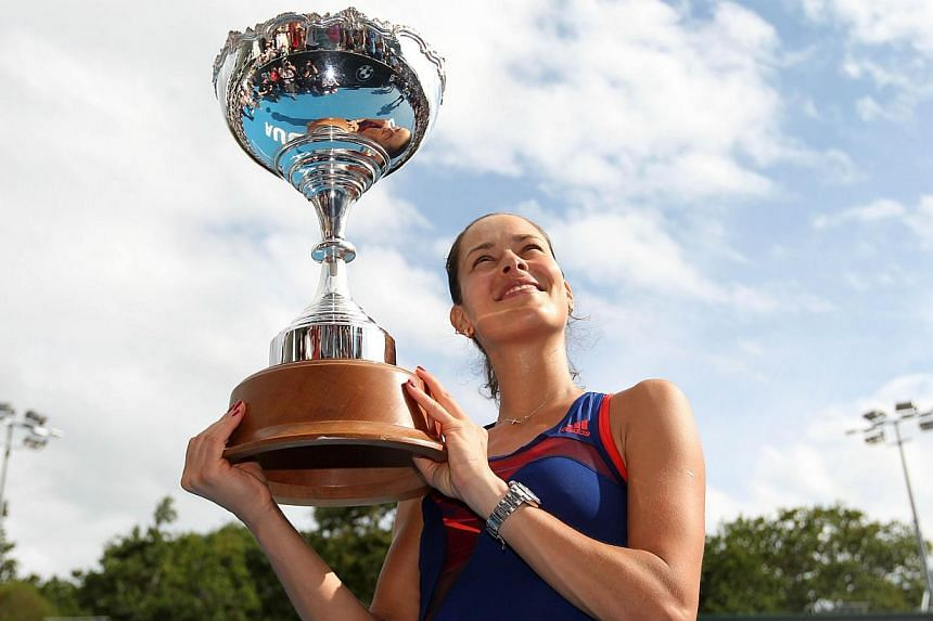 Ana Ivanovic of Serbia holds her trophy after her win during the final against Venus Williams of the US at the ASB Classic tennis tournament in Auckland on Jan 4, 2014. Ivanovic claimed her first WTA Tour title in more than two years with a 6-2 5-7 6