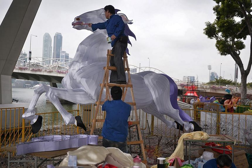 Craftsmen from Sichuan Zhi Gong City prepare a giant horse lantern during the media preview of the River Hongbao 2014, held on Jan 3, 2014. There will be 28 large handmade lantern displays at this year's carnival, to be held at the Floating Platform