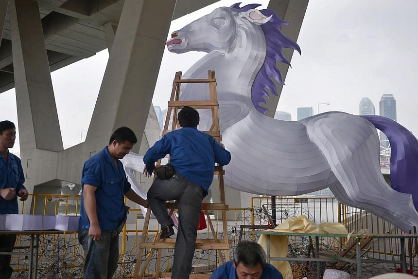Craftsmen from Sichuan Zhi Gong City pictured with a giant horse lantern during preparations at the media preview of the River Hongbao 2014, held on Jan 3, 2014. There will be 28 large handmade lantern displays at this year's carnival, to be held at
