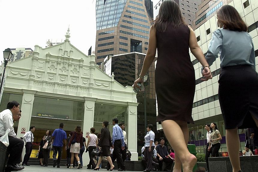 Office workers and people in the central business district - Raffles Place. Workers are not likely to get bumper payouts in the current bonus season and salary increases are expected to be modest this year in a slowing economy, surveys indicate.