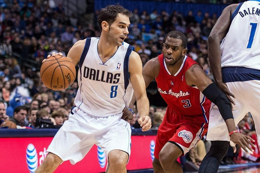 Dallas Mavericks point guard Jose Calderon (No. 8) dribbles past Los Angeles Clippers point guard Chris Paul (No. 3) during the first quarter at the American Airlines Centre. The Los Angeles Clippers' star point guard Chris Paul could be sidelined fo