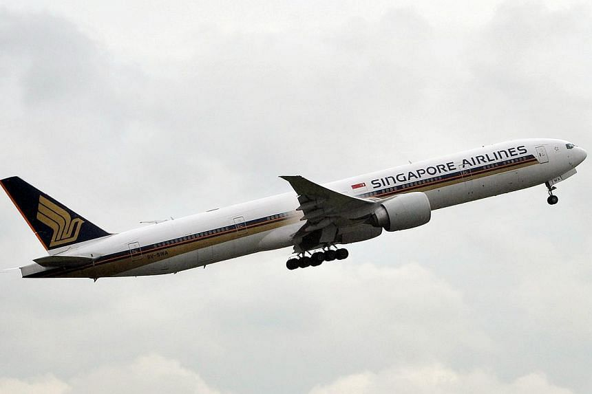 Singapore Airlines will axe 19 flights to Bangkok in the coming weeks as political tensions in the Thai capital keep some travellers away. -- ST FILE PHOTO:ALPHONSUS CHERN