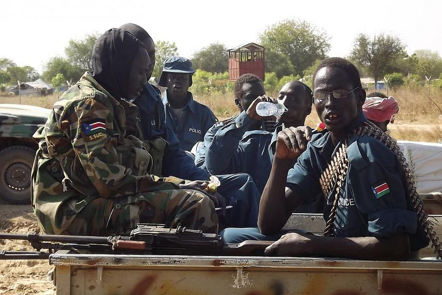 South Sudan army soldiers talk on Dec 25, 2013 at Bor airport after they re-captured the town from rebels. South Sudan's warring parties are set to begin direct talks on Saturday in a bid to end the conflict pushing the world's youngest nation toward