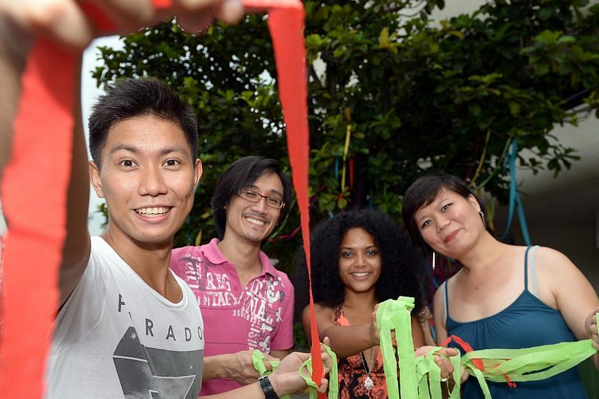 Ms Suarez's brother Joshua (left) with the organisers of yesterday's fund-raising event at Home Club (from left) Elwin Goh, 32, Deborah Emmanuel, 25, and Olivia Kwok, 27. The event raised $3,000 for Ms Suarez's family.