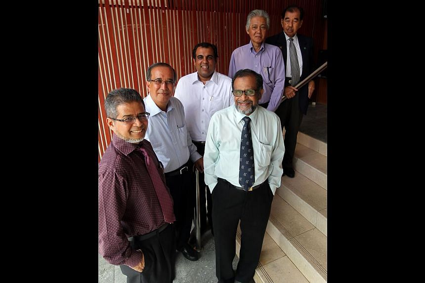 Among those involved in the online free legal clinic iCounsel are (from top, anti-clockwise) volunteer lawyers Yahya Syed, Mak Kok Weng and Pratap Kishan, with Jamiyah vice-presidents Isa Hassan, Mohamed Yunos and H.M. Saleem. -- ST PHOTO: SEAH KWANG