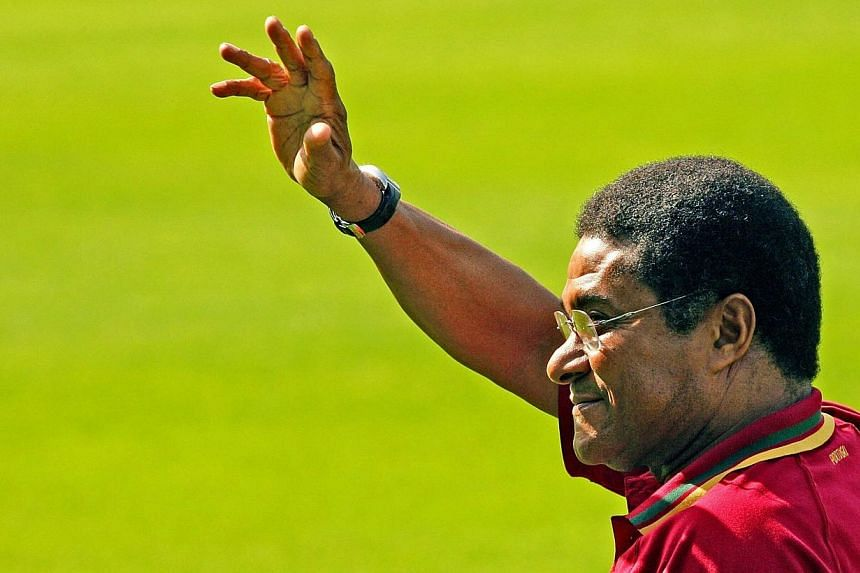 Football legend and former Portugal's national team player Eusebio da Silva Ferreira, more commonly known as Eusebio, waving to the crowd during Portugal's team training session at the Heidewald Stadium in Gutersloh, onJune 18, 2006.Euseb