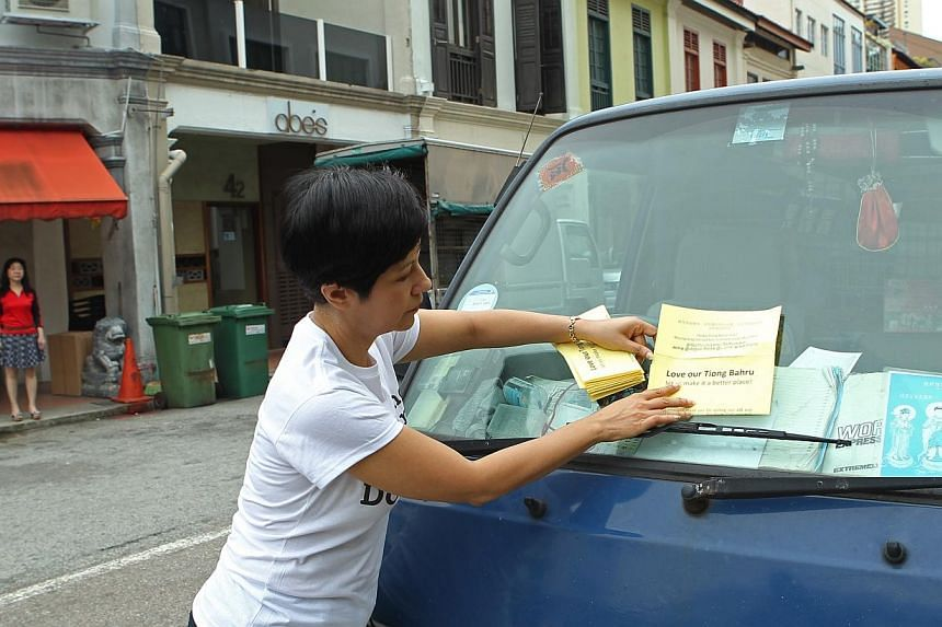 About 20 Tiong Bahru residents, volunteers and MP Indranee Rajah (pictured) took to the streets of the conservation estate on Sunday morning to discourage drivers and visitors of the estate from parking illegally. -- ST PHOTO:SEAH KWANG PENG