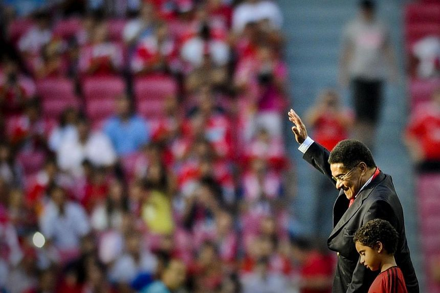 Former Portuguese football legend Eusebio da Silva Ferreira, more commonly known as Eusebio, leaving the pitch at the end of the Eusebio Cup football match at the Luz Stadium in Lisbon, on July 27, 2012. -- FILE PHOTO: AFP