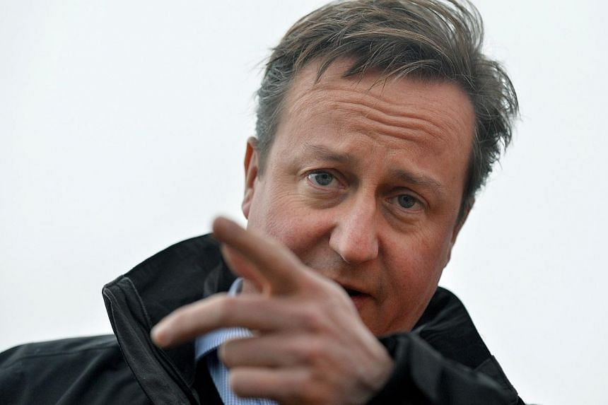 Britain's Prime Minister David Cameron promised on Sunday to protect pensioners' income if his Conservative party wins the 2015 election, laying out his first manifesto spending pledge. -- FILE PHOTO: REUTERS
