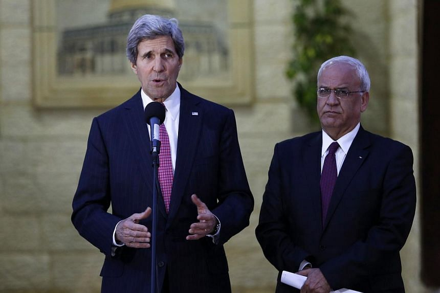U.S. Secretary of State John Kerry (L) and Chief Palestinian negotiator Saeb Erakat (R) give a statement to the press after the meeting with Palestinian President Mahmoud Abbas in the West Bank city of Ramallah, on Jan 4, 2014. US Secretary of S