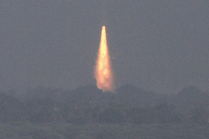 India's Geosynchronous Satellite Launch Vehicle (GSLV-D5) blasts off carrying a 1980 kg communication satellite from Sriharikota, about 100 km north of Chennai on January 5, 2014. --PHOTO: REUTERS