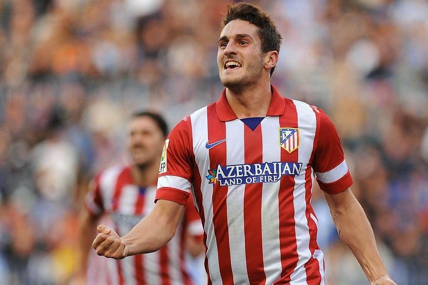 Atletico Madrid's midfielder Koke celebrates after scoring during the Spanish league football match between Malaga CF and Atletico Madrid on Jan 4, 2014 at Rosaleda stadium in Malaga. Atletico Madrid moved three points ahead of Barcelona at the top o