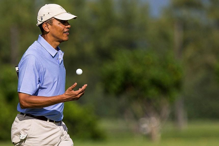 US President Barack Obama walks on the second hole green at the Kaneohe Klipper Golf Course at Marine Corps Base Hawaii on January 2, 2014 in Kaneohe, Hawaii. MrObama swaps the sun-dappled golf courses of tropical Hawaii for a Washington in the