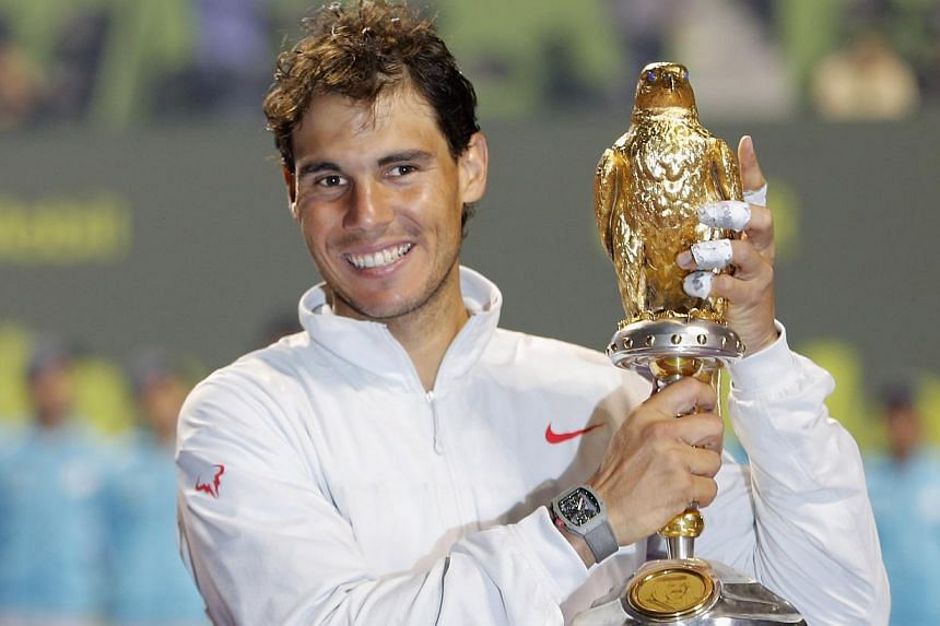 Rafael Nadal of Spain holds his trophy after winning the Qatar Open men's final tennis match in Doha on Jan 4, 2014. Rafael Nadal at last made a title-winning start to a year when he held off Gael Monfils 6-1, 6-7 (5/7), 6-2 to clinch the Qatar Open