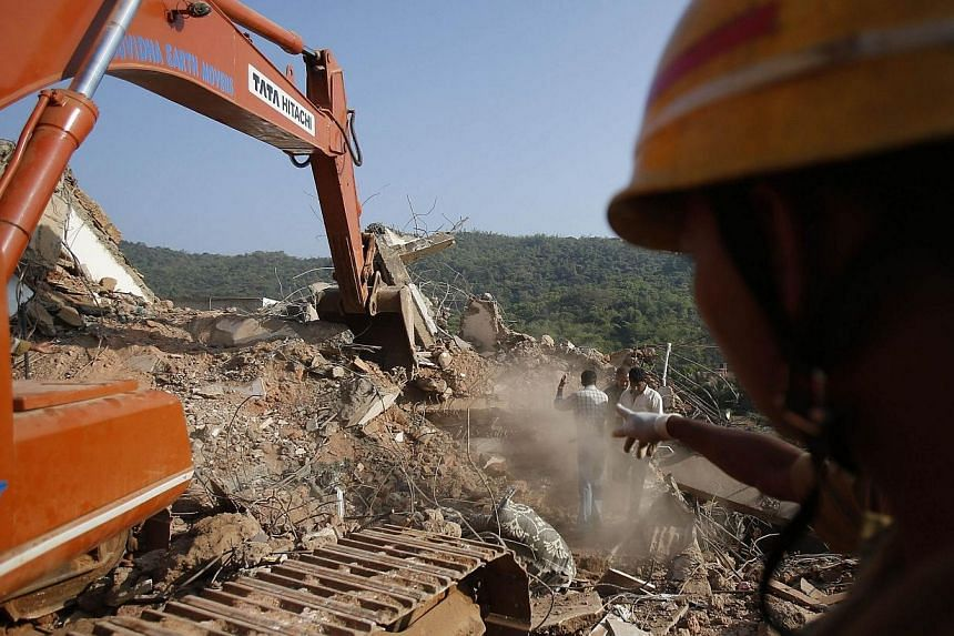 Rescuers search for survivors at the site of a collapsed building that was under construction in Canacona town in the western Indian city of Goa, on Sunday, Jan 5, 2014. -- PHOTO: REUTERS