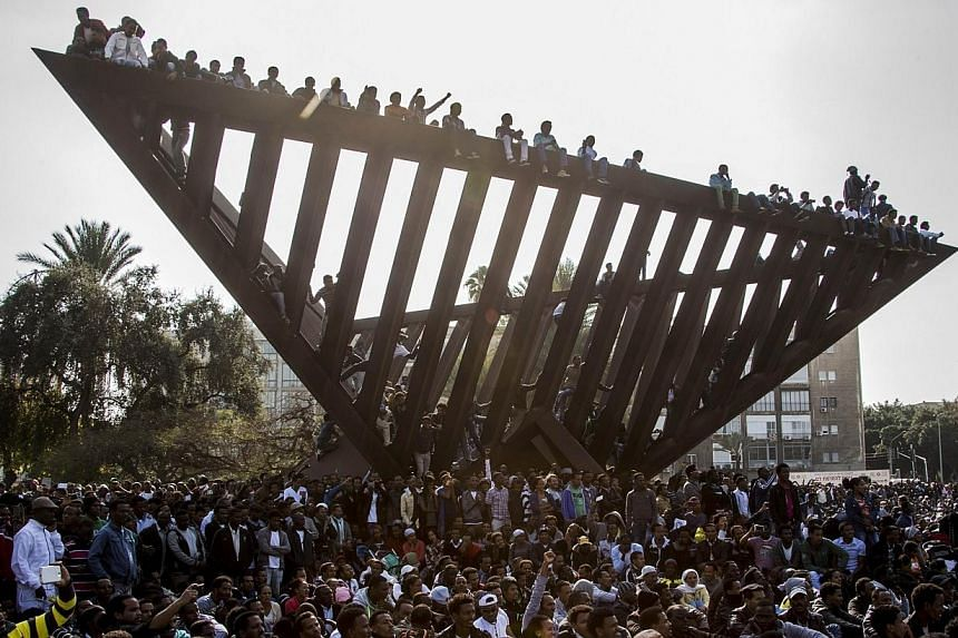 Thousands of African asylum seekers who entered Israel illegally via Egypt stage a protest in Tel Aviv, on Jan 5, 2014, slamming the Jewish state's long-term detention of illegal immigrants.-- PHOTO: AFP