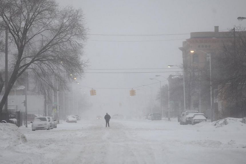 A man walks along a snow covered Cass Avenue in Detroit, Michigan on Jan 2, 2014. Many parts of the United States (US) Midwest braced for a blast of Arctic air this weekend that could bring some of the coldest temperatures in two decades before advan