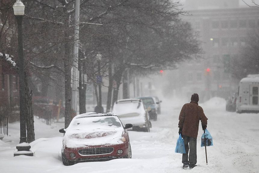 A man uses his cane to navigate a snow covered road in Detroit, Michigan on Jan 2, 2014.Many parts of the United States (US) Midwest braced for a blast of Arctic air this weekend that could bring some of the coldest temperatures in two decades before