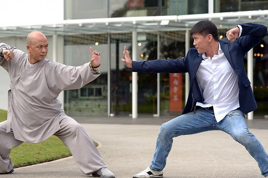 Master Dehong (left) of the Henan Shaolin Wushu Academy and Mr Vincent Ng of Wufang Singapore demonstrating wushu stunts at VivoCity last week. Trainers from the Shaolin academy will be here, starting this June.