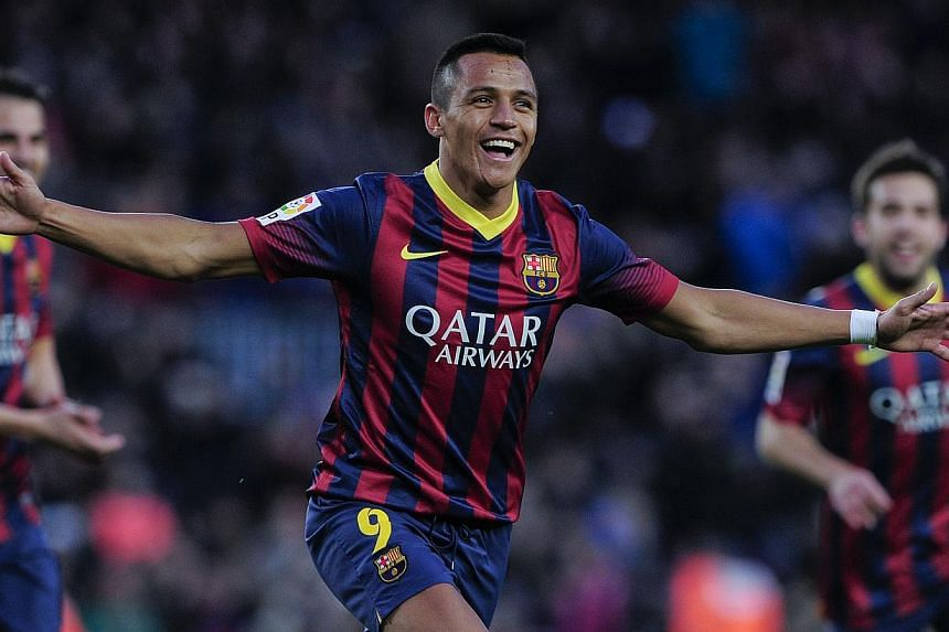 Barcelona's Chilean forward Alexis Sanchez celebrates after scoring during the Spanish league football match FC Barcelona v Elche CF at the Camp Nou stadium in Barcelona on Jan 5, 2014. Sanchez hit a treble as Barcelona swept aside Elche 4-0 to retur