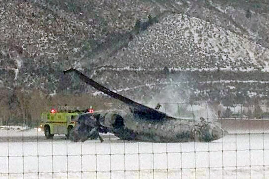 The wreckage of a private jet lies on the runway after it crashed and burned as it landed at Aspen/Pitkin County Airport in Colorado on Jan 5, 2014. One person was killed when a private jet crashed and burst into flames on Sunday while landing at the